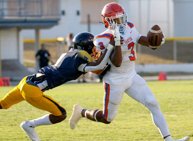 Bartow running back Jordy Lowery breaks the tackle of a Winter Haven defender on Thursday night.
