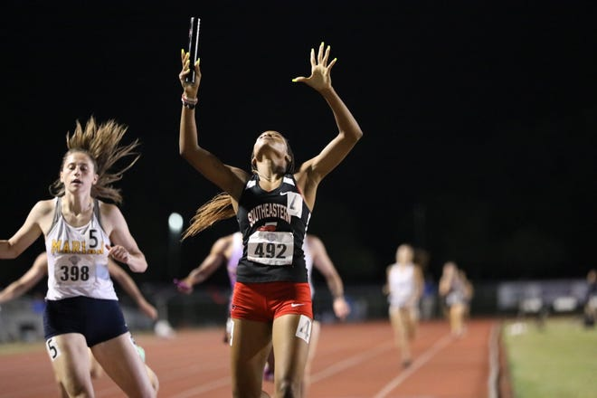 Southeastern's Courtney Gales crosses the line as the Fire won their heat in the 4X400 relay on Thursday in Gulf Shores, Alabama.