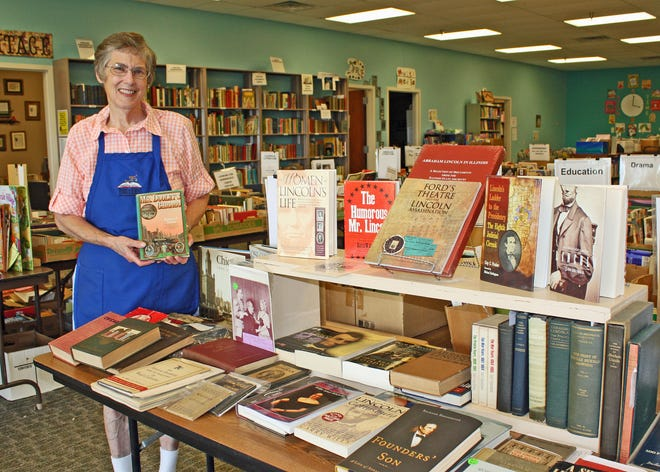 Dr. Mary Ryder, a retired professor and a volunteer at Books to Benefit, checks over Chicago and Abraham Lincoln books available at the Books to Benefit sale June 3, 4, and 5. Sale hours begin from 4 to 8 p.m. Thursday with a $10 donation at the door. No entry fee will be charged for shopping on Friday from 10 a.m. to 7 p.m. or Saturday from 11 a.m. to 5 p.m. The sale will be at Books to Benefit, 360 Wylie Drive, Suite 700, in the Crossroads Mall. Masks will be required, with no exceptions.  The mall is just off of the intersection of Route 9 and Wylie Drive about a half mile north of Farm and Fleet in Bloomington. An estimated 20,000 books will be offered, with sale proceeds going to support literacy programs in McLean County. Sale highlights include hundreds of children's books for 50 cents each, a huge history section, a Frank Lloyd Wright collection, current mysteries and novels, sci-fi, art books, vintage books and rare books. For more information: www.books2benefit.com.