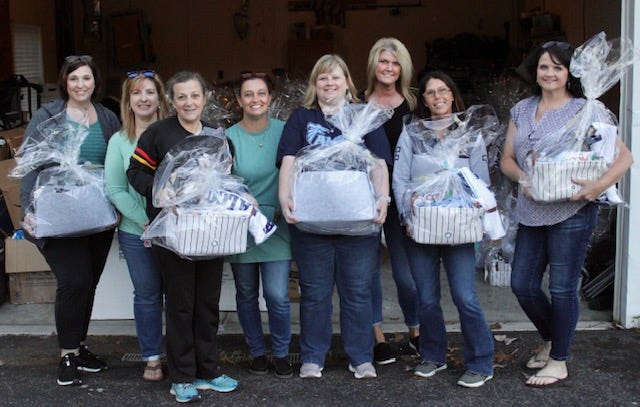 Frankfort parents assembled recently at the home of Melissa Clark to put together gift baskets they are providing for each of Frankfort's graduating seniors.