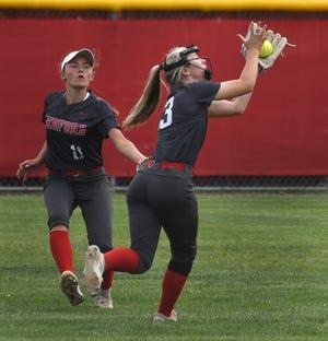 Second baseman Payton Pudlowski of Bedford runs down a pop up in front of right fielder Maddie Henegar Thursday.
