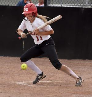 Monroe High School senior Ellie Sieler puts down a infield bunt single.