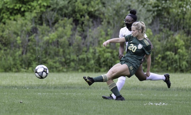 St. Mary Catholic Central's Kelsey Beggs launches a left-footed shot against Ypsilanti Arbor Prep Thursday. Beggs scored four goals to lead the Kestrels to a 9-1 District Tournament victory.