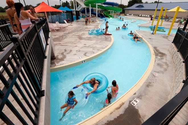 Swimmers float the lazy river at the Westwood Aquatic Center during a previous summer swim season.