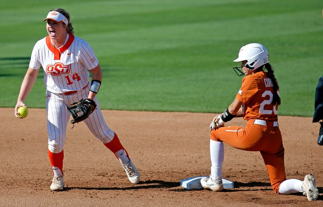 Oklahoma State infielder Karli Petty celebrates after tagging out Texas' Camille Corona on an attempted steal at Cowgirl Stadium in Stillwater, Okla., on Friday. Oklahoma State won 6-1 in the opening game of their super regional.