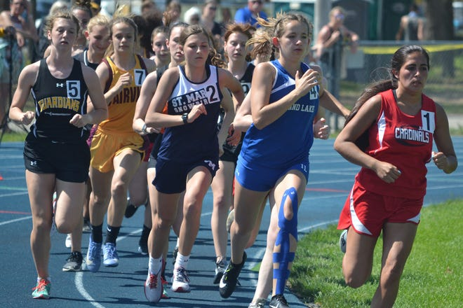 Johannesburg-Lewiston's Adelaida Gascho, far right, leads the way early in the girls 800-meter run in a Division 4 regional track and field meet in Indian River on Saturday, May 22. Gascho and the JoBurg girls followed up a regional title won in Indian River by capturing the Ski Valley Conference title.