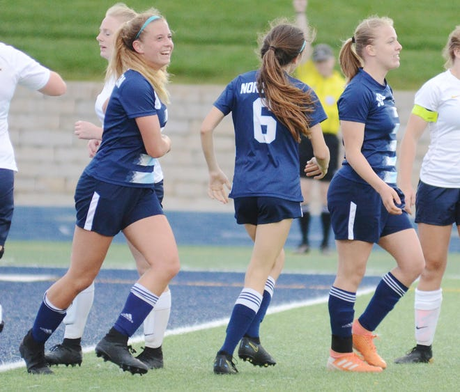 Hayley Flynn (far right) scored three goals and added an assist in a 4-1 district opening win, while Autumn Naturkas (far left) had a pair of assists.