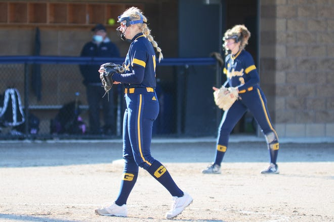Abby Radulski (front), Avery Parker (right) and the Blue Devil softball team finished out the regular season with a 34-1 record.