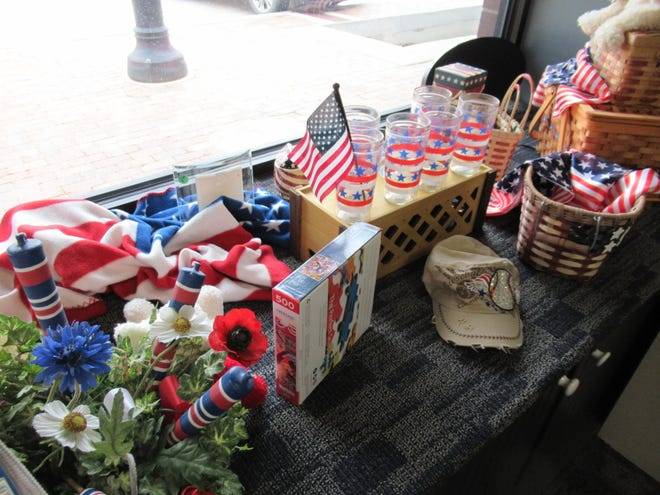 The front window of the Kiowa County Care & Share is bright with red, white, and blue decor just in time for the current holidays.