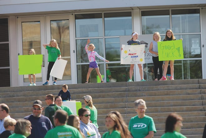 An enthusiastic crowd met at the Pratt High School parking lot Friday morning to send the 2021 Lady Greenbacks softball team off to the 4A state tournament this weekend.