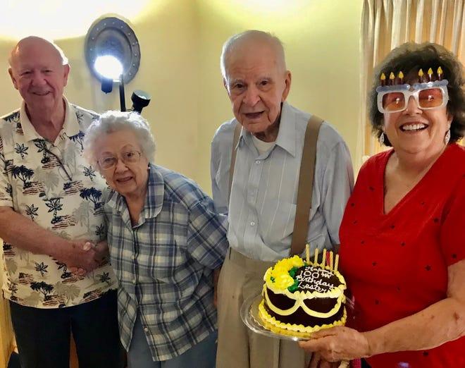 Colonial Heights neighbors from left to right, Joe Hales, Sophie and her late husband Word War II Navy veteran Lester Wawner, and Betty Hales celebrate Lester turning 100 years old on July 21, 2020.