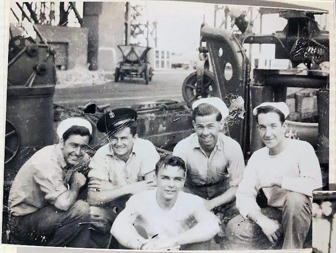 Joseph Crevier, left, with fellow sailors during World War II.