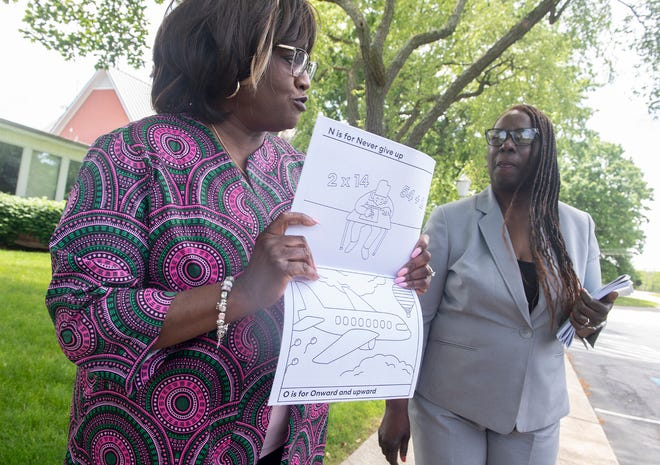 """Dr. Geraldine Hayes Nelson, president of the Portage County NAACP, and Renee Romine, vice president, show off the """"Social Justice Coloring Book,"""" which the group recently produced to teach youth the importance of social justice."""