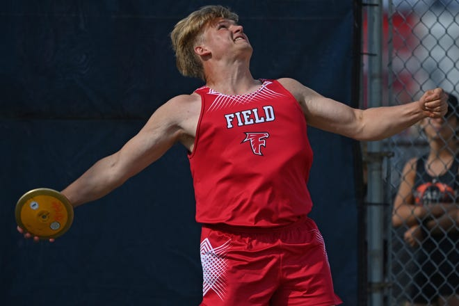 Field's Grant Wise competes during the boys discus throw, Thursday evening during the Division 2 Regional Track Meet at Austintown Fitch High School.