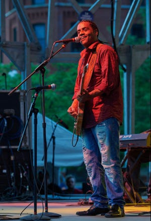 A musician performs at a previous Canton Blues Fest in downtown Canton. The event returns July 9 and 10 at Centennial Plaza. Tickets can be purchased online through the Canton Regional Chamber of Commerce.