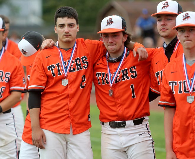 Caden Pachis, 2, and Shane Rue, 1, of Massillon react after their 3-0 loss to Mayfield in their Division I district final at Thurman Munson Stadium on Thursday, May 27, 2021.
