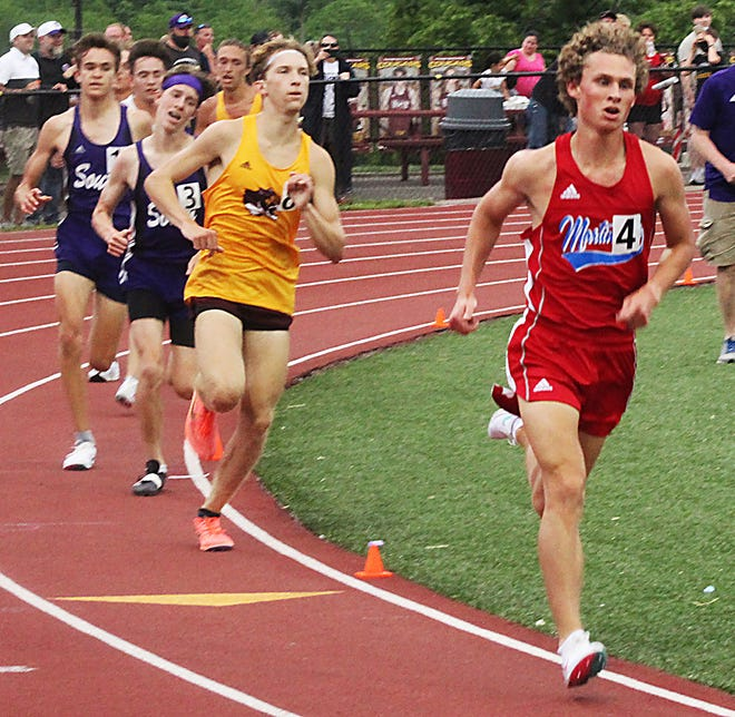 Carson Heath, a Martinsville senior, starts to pull away from the lead pack on the final lap of Thursday's 3200 meters in the Bloomington North regional. (Steve Page / Correspondent)