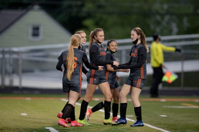 Members of the NIC-10 champion Freeport girls soccer squad celebrate one of their six goals in a shutout win over Guilford on Thursday, May 27, 2021, in Freeport.