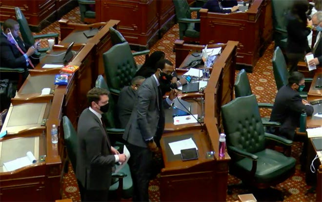 Illinois state Rep. Curtis Tarver, D-Chicago, introduces a Supreme Court redistricting bill Friday, May 28, 2021, on the floor of the Illinois House. He said he did not draw the district lines in the bill, did not know who did, and did not know how they were drawn.