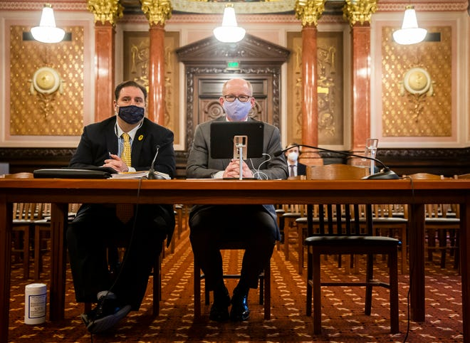State Senate President Don Harmon, D-Oak Park, center, answers questions during the Illinois Senate Redistricting Committee hearing at the state Capitol on Friday.