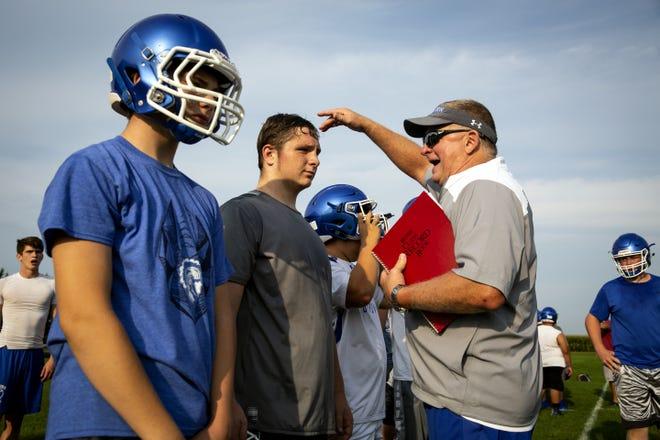 Auburn High School head football coach Dave Bates talks with players on the team's first day of practice Monday, Aug. 6, 2018 at Auburn High School.