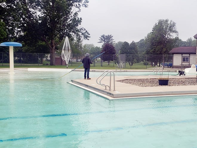 With the temperature at a brisk 46 degrees Friday, park district workers began to prepare the Oasis Family Aquatic Center for its opening day on June 7. Upgrades to the swimming pool is on the list of shovel-ready projects the Kewanee Park District is compiling for the second round of Rebuild Illinois community grants.