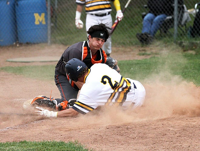 Sturgis catcher Taner Patrick blocks the plate to record an out against Mattawan in prep baseball action on Thursday.