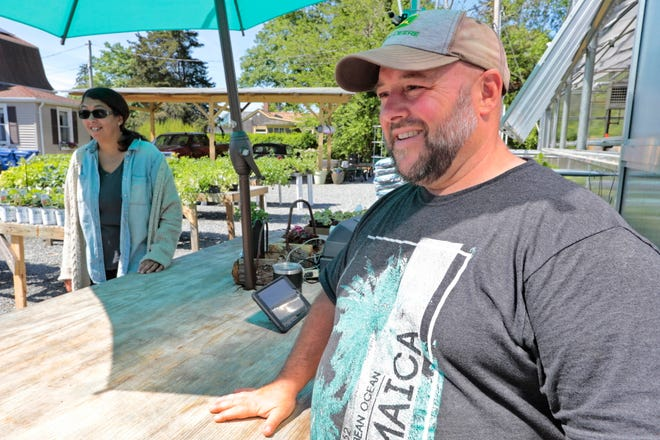 Owners, Mike Tremblay and his wife Dawn Trembley greet customers at Lawrence Family Greenhouses, on Hathaway Road in New Bedford.