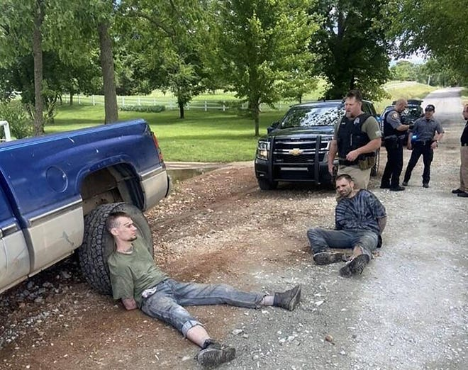 Hopkins and Martslof handcuffed following their capture.