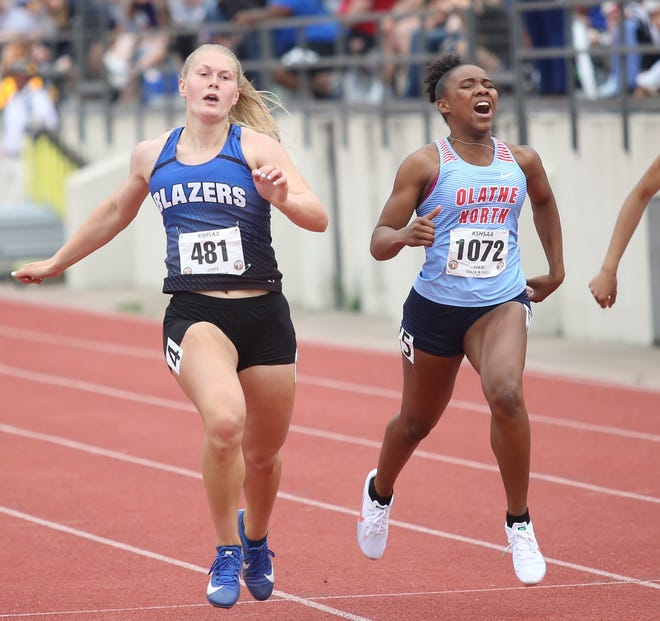 Gardner-Edgerton's Kendra Wait (left) edges Olathe North's Ka'Liyah McGinnis (right) for the Class 6A state title in the 100-meter dash. Wait captured four state titles at Thursday's State Outdoors, also winning the shot put, long jump and pole vault.