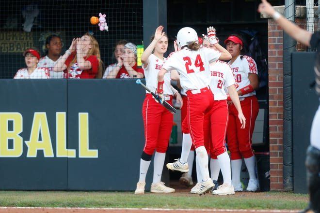 The Shawnee Heights dugout celebrates a run during Thursday's 5A semifinal state game at Wichita State University.