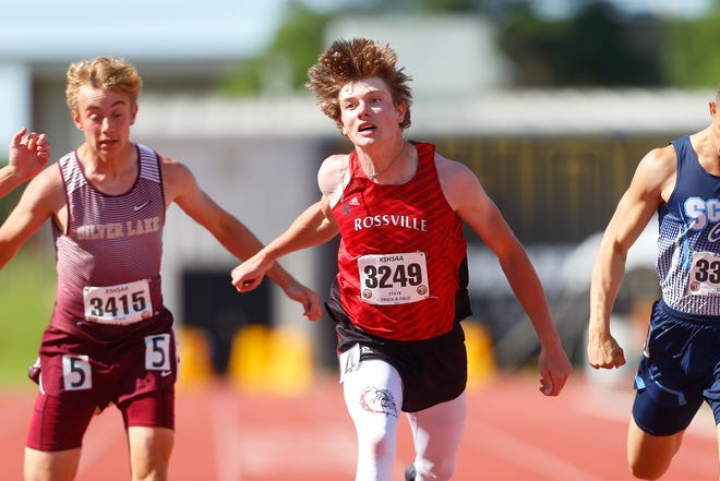 Rossville's Woodrow Rezac wins the 200 meter dash with a time of 22.15 at Friday's 3A state championship at Wichita State University.