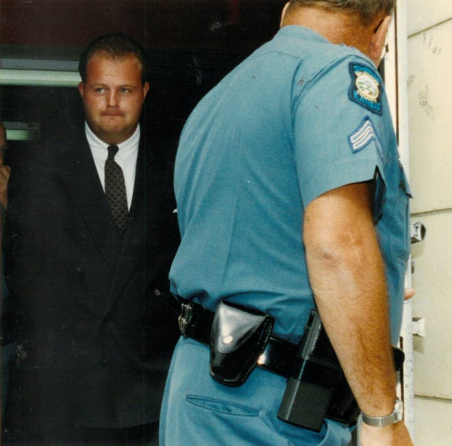 Eric Sims, then 24, was escorted in 1992 to a hearing in Shawnee County District Court.