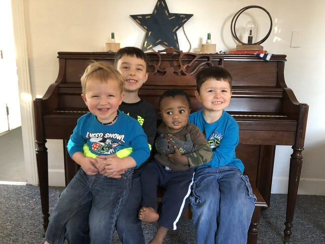 Darrell and Cassandra Cohn of Dighton began fostering Mason when he was 3 months old and later adopted him. From left, brothers Jeremiah, Benjamin, Mason and Zachary in 2018.