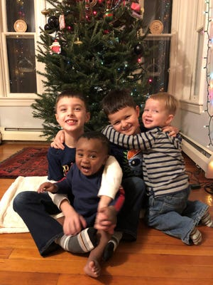 Darrell and Cassandra Cohn of Dighton began fostering Mason when he was 3 months old and later adopted him. From left, brothers Benjamin, Mason, Zachary and  Jeremiah.