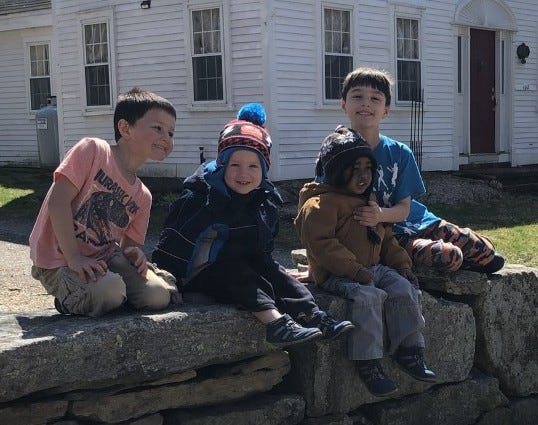 Darrell and Cassandra Cohn of Dighton began fostering Mason when he was 3 months old and later adopted him. From left, brothers Zachary, Jeremiah, Mason,  and Benjamin in 2020.