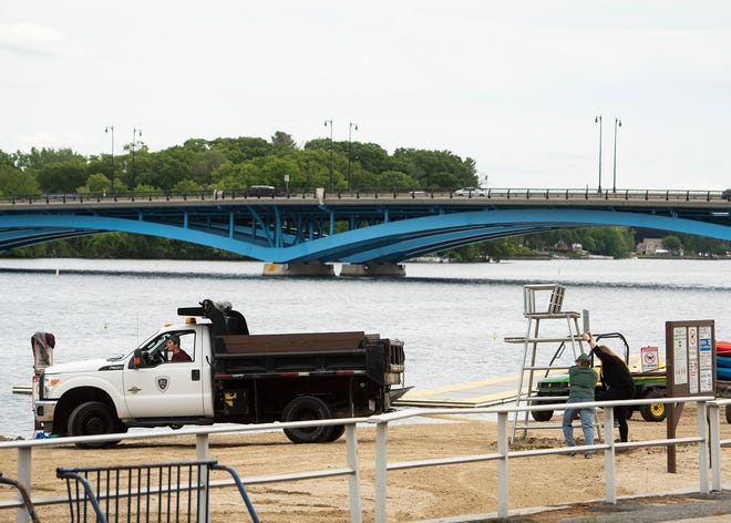 """Lifeguard towers are put into place at Regatta Point on Lake Quinsigamond in Worcester on Friday by the state Department of  Conservation and Recreation. A team of local and state law enforcement agencies have created the Lake Quinsigamond Task Force as a way to """"increase public safety and marine compliance"""" on and around the lake this summer."""