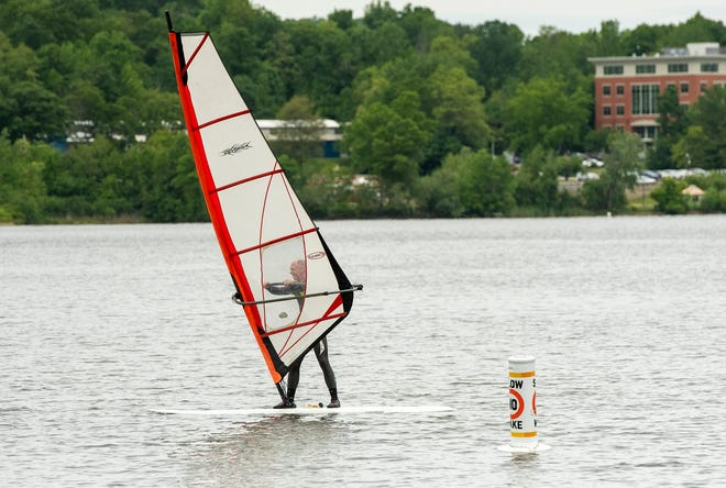 A wind surfer rides out from Morgan Park on Indian Lake in Worcester last month.