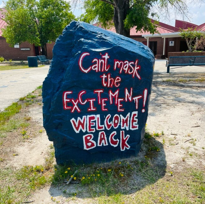 A hand-painted boulder sits in front of Max Abbott Middle School in Cumberland County.