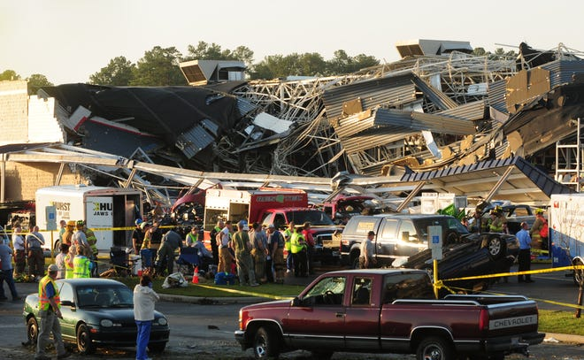Rescue workers at the scene of Lowe's in Sanford where a tornado destroyed the building on Saturday, April 16, 2011.