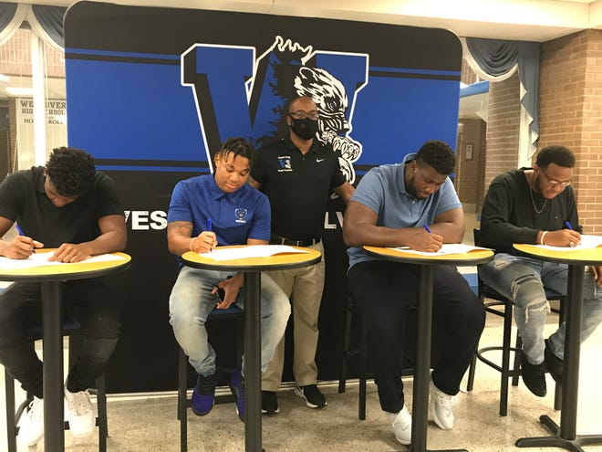 Four Westover football players celebrated their college choices Thursday in a signing ceremony at their high school.