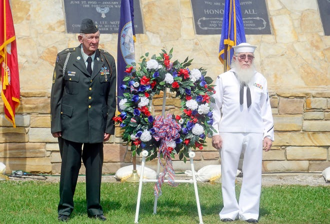 Frank Godfrey, left, and Edward Moon present a wreath at the war memorial during a past Gadsden-Etowah Patriots Association Memorial Day program at Col. Ola Lee Mize Patriots Park. This year's event is at 10 a.m. Monday.