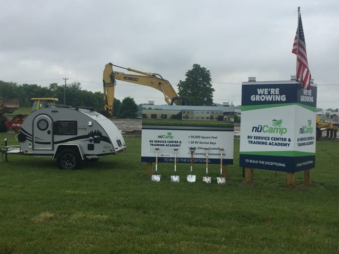 nuCamp, the nation's largest manufacturer of campers and teardrop trailers, has broken ground for its new service center and training academy in Sugarcreek.