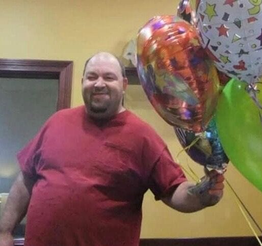 Michael Parker with balloons his wife Charity sent for his birthday.