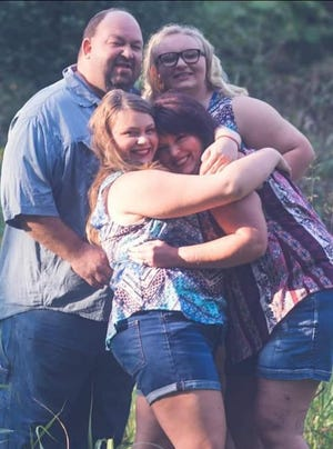 Michael Parker was a loving family man who always remembered his wife with flowers on her birthday and their anniversary. Above are Michael, Charity and their daughters Madison and Michaela.