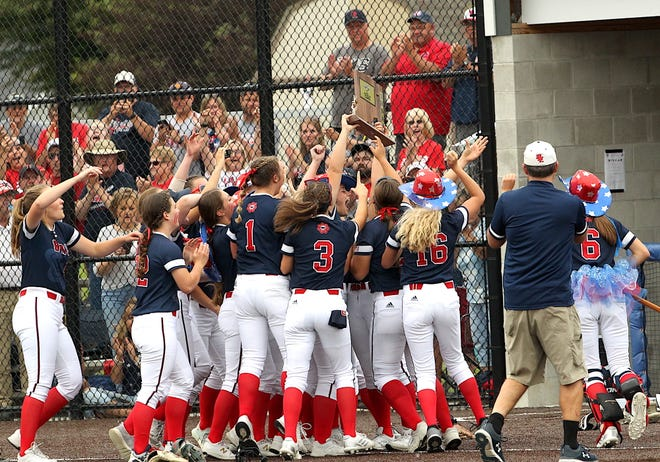 The BNL softball team celebrates after recording the final out in a 4-1 victory over Floyd Central in the championship game of the Jennings County Sectional Thursday night.