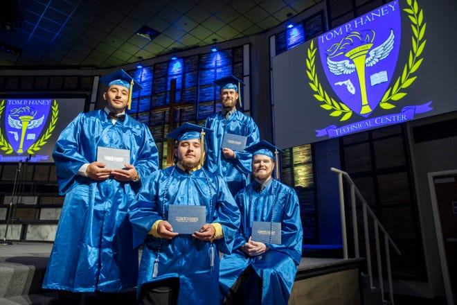 Haney Tech had two sets of brothers graduating from its programs Thursday night at Hiland Park Baptist Church. Michael Mancia, left, and his brother Marck, second from left, graduated with degrees in HVAC and electrical. Cole Moreau and his brother, Seth, right, graduated with degrees in automotive collision and computer systems.