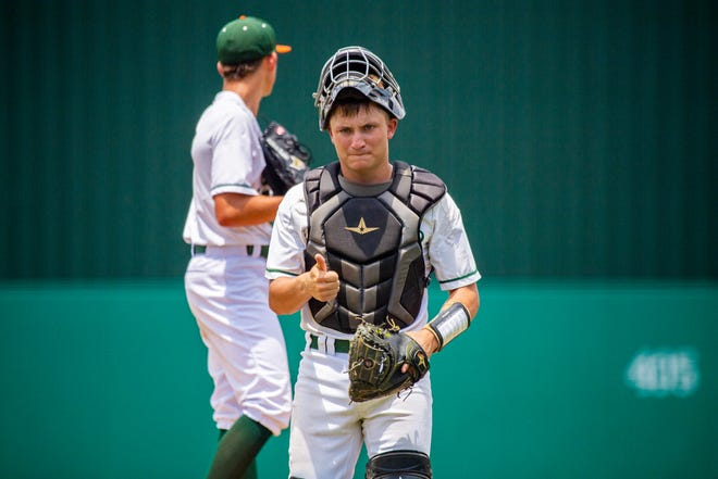 Mosley catcher Coleman Rowan walks back to home plate after visiting brother Hudson Rowan on the mound during the 5A state championship game against Archbishop McCarthy on Wednesday, May 26, 2021.
