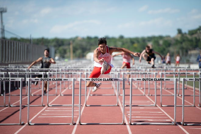 Centennial High School's Troy Silver clears the last of the 110-meter hurdles far ahead of competition at Dutch Clark Stadium on Thursday May 27, 2021.