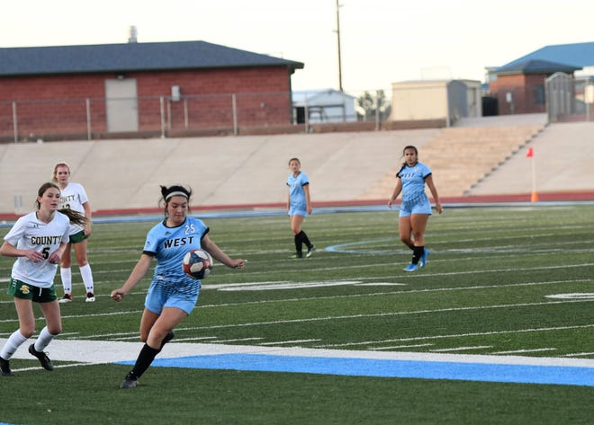 Pueblo West High School junior, Erica Pacheco races to the ball in a game against Pueblo County May 27, 2021.